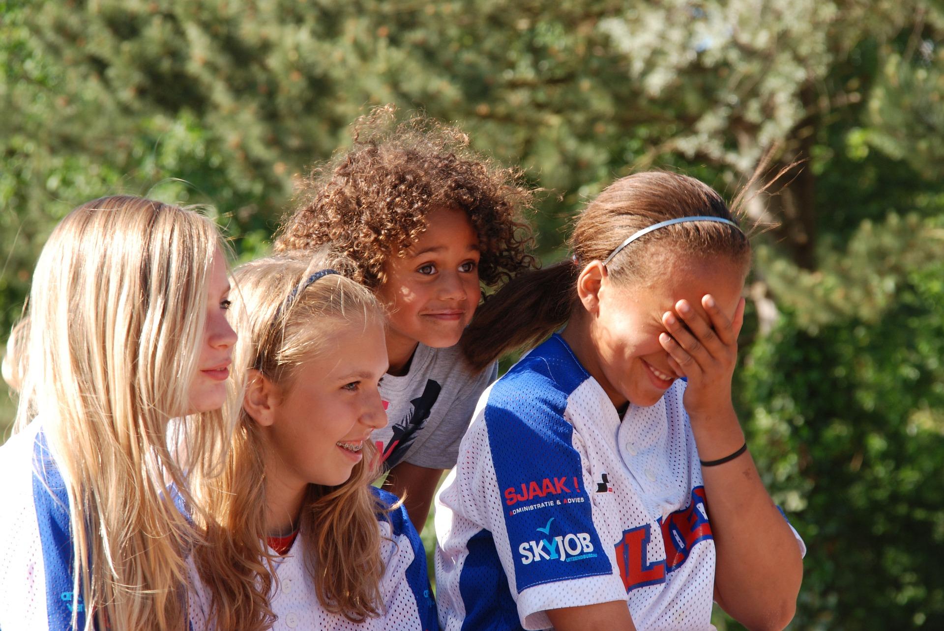 girls smiling at game
